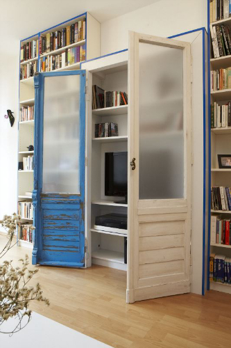 bookshelf with upcycled balcony doors